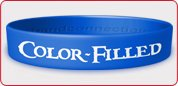 COLOR-FILLED SILICONE WRISTBANDS